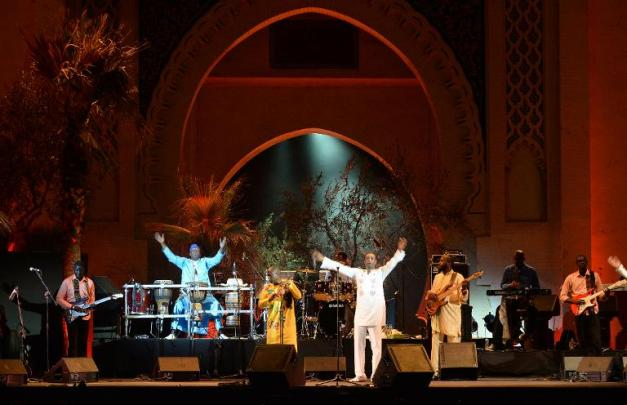 Senegalese singer Youssou N'Dour peforms during the 20th edition of the World Sacred Music Festival in Fez, Morocco, on June 16 ,2014. AFP PHOTO / FADEL SENNA