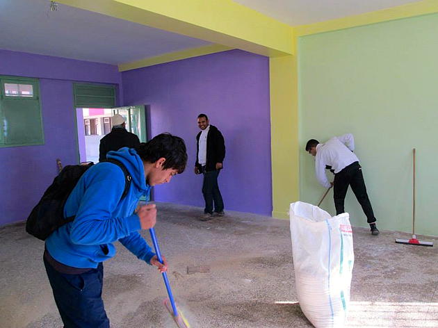 Students work on renovating the library.
