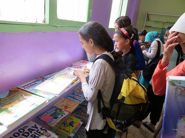 Students perusing the collection at the Erfoud English library.