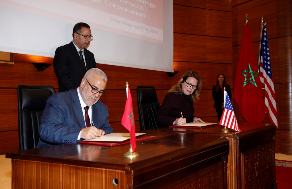 Moroccan Prime Minister Abdelilah Benkirane and MCC CEO Dana J. Hyde sign the second MCC compact.