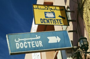 Signs for a doctor's and dentist's office in Morocco. Photo: Bryan Thomas on Flickr.