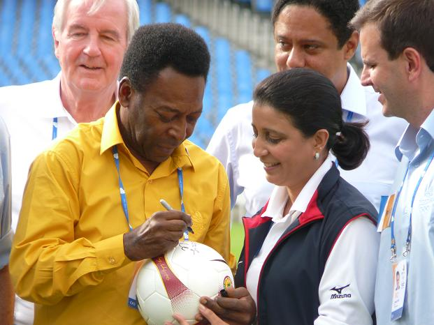 Pele signs a soccer ball for Nawal El Moutawakel - Photo by Around the rings1992