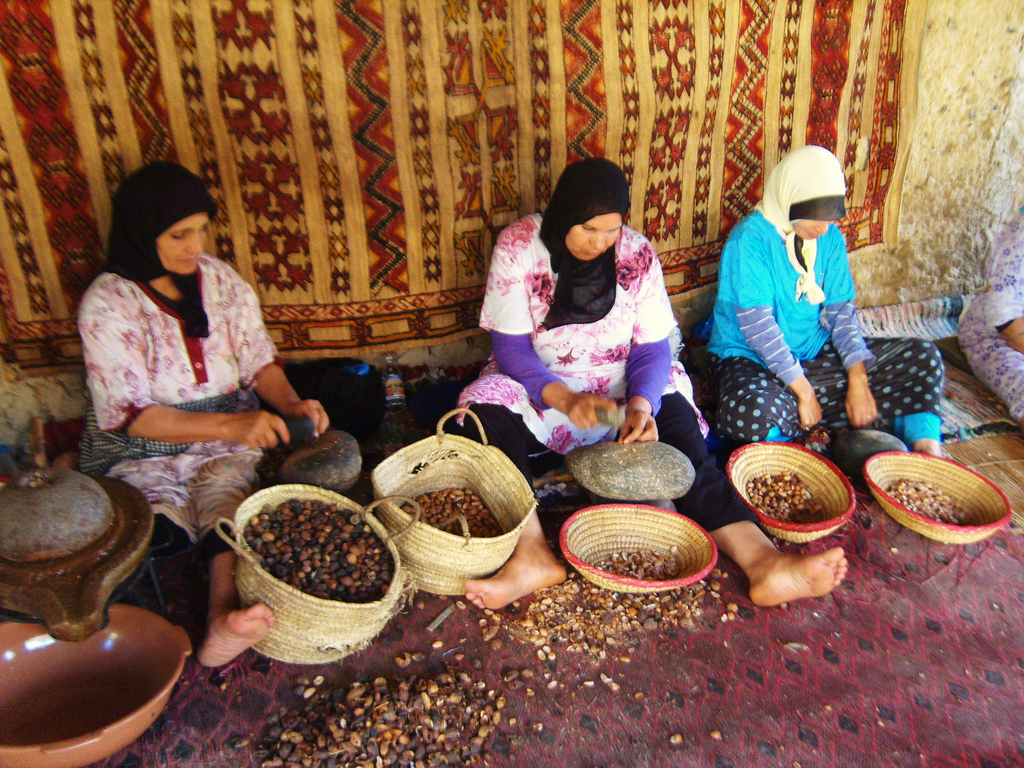 "Women processing argan seeds in Morocco. Photo by ""Jessica on Paper"" on Flickr."