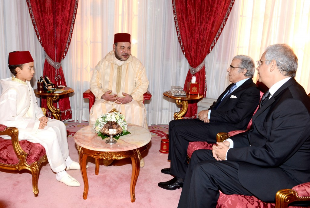 Morocco's King Mohammed VI, accompanied by Crown Prince Moulay El Hassan, receives Nizar Baraka (far right), chairman of the Economic, Social and Environmental Council (CESE) and Abdellatif Jouahri, governor of Bank Al Maghrib. In his 15 year anniversary speech to the nation, the King called on CESE to carry out a study of Morocco's wealth, its intangible capital and distribution, and provide recommendations.  July 30th, 2014.  Photo: MAP
