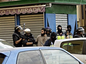 Spanish police officers arresting a suspect on Friday in Melilla, a Spanish enclave in North Africa. Photo: F. G. Guerrero European Pressphoto