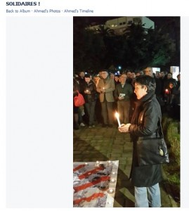 Soad Begdouri El Khammal lighting a candle in memory of the victims of the Charlie Hebdo attacks