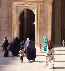 Women outside King Hassan II mosque in Casablanca.
